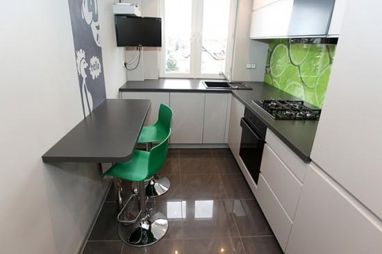 Г-образное расположение мебели помогает с пользой задействовать зону под окном