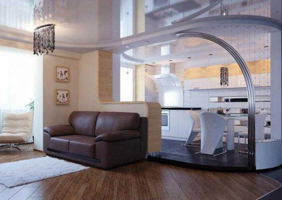 Зонировать пространство можно с помощью арки, подиума или цвета